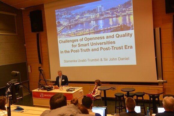 Sir John Daniel and Stamenka Uvalić-Trumbić giving their keynote on challenges of openness and quality for smart universities in the post-truth and post-trust era.