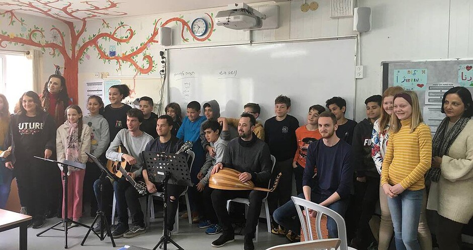 "Students Vetle Rødningsby, Adrian Mcallister and Espen Jægersborg with the palestinian musician Loab Hammod at the school ""Hand in Hand Center of Jewish-Arab Education"" in Galilee. (Photo: Private)"