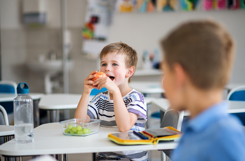Photo of a pupil eating fruit