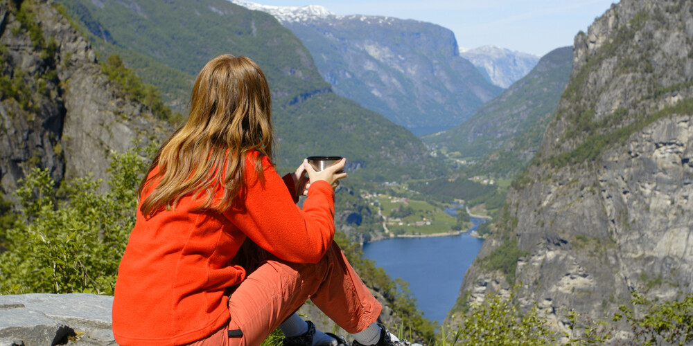 Student sits and looks out over the fjord