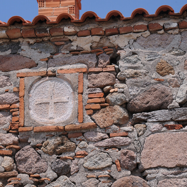 The Byzantine cross at the old stone wall